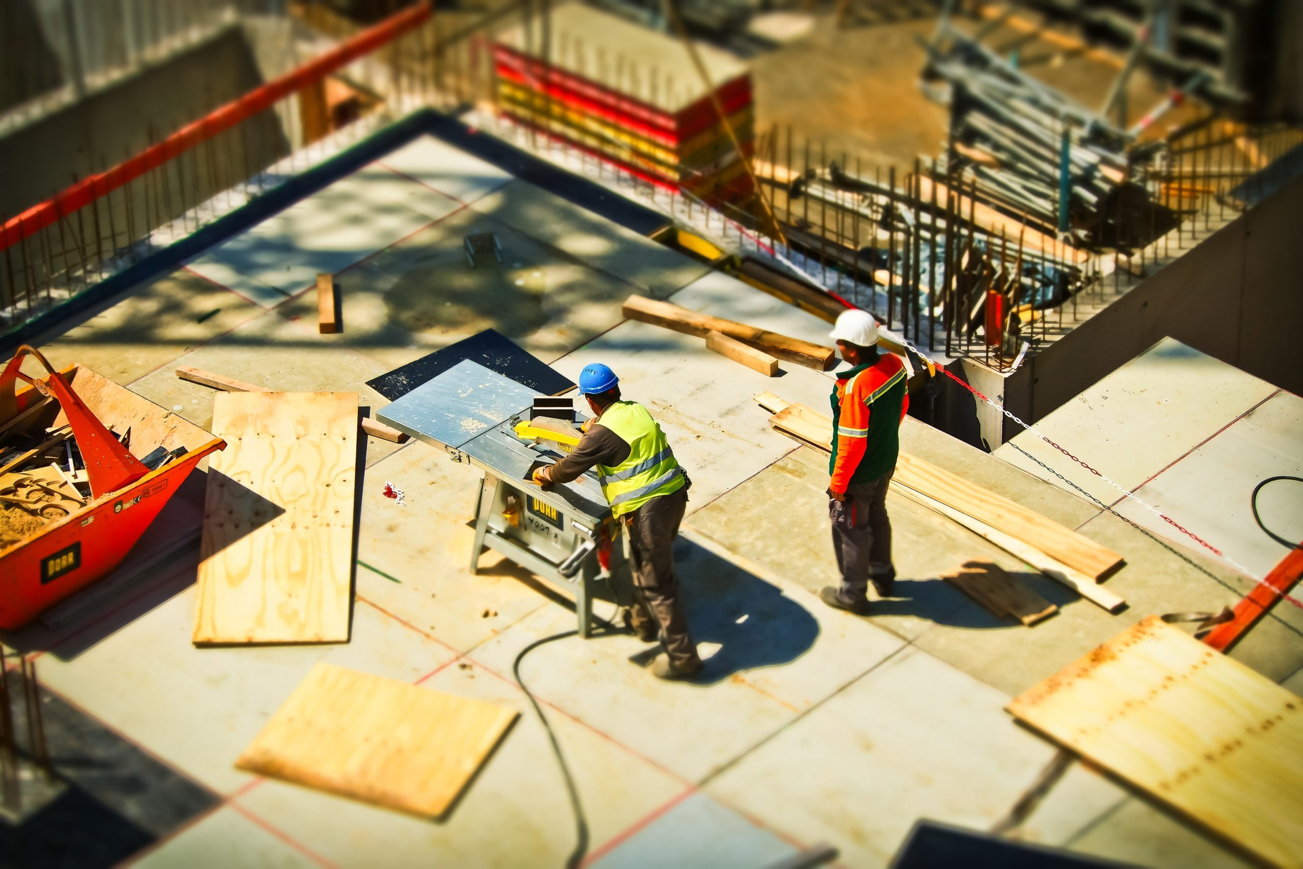 2-man-on-construction-site-during-daytime-159306